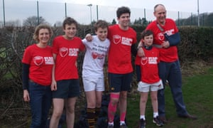 Every step of the way: 12-year-old James Gray (in white) with his family. Despite his injury, James intends to play rugby again.