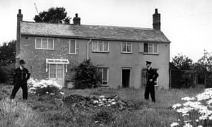 13th August 1963:  Police stand guard outside Leatherslade Farm at Oakley in Buckinghamshire, used as a hide-out by the Great Train Robbers.