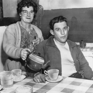 Train driver David Whitby gets a cup of tea from his mother at home in Crewe, Cheshire, 18th August 1963. Whitby was co-driver of the mail train, which was hijacked in the 2.6 million pound Great Train Robbery, committed ten days previously at Ledburn, Buckinghamshire.