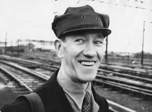 Train driver Jack Mills (1905 - 1970) returns to work after 39 weeks of sick leave, 12th May 1964. Mills was beaten with an axe handle during the 2.6 million pound Great Train Robbery committed at Ledburn, Buckinghamshire, on 8th August 1963.