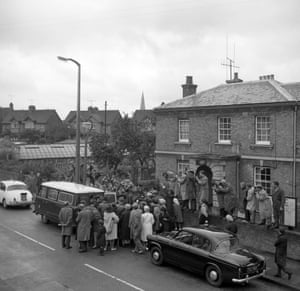 Sightseers crowd around the van at Linslade, Buckinghamshire, as some of the five accused leave the hearing to be remanded in custody on charges in connection with the with the Glasgow-Euston mail train robbery.