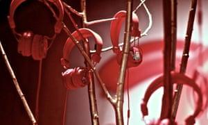 UrbanEars headphones hang in an art piece.