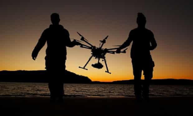 Drone operator, Ken Butti and Camera operator, Robbie Josephsen carry the custom built DJI s1000 Drone following a flight at Palm Beach on July 4, 2014 in Sydney, Australia.