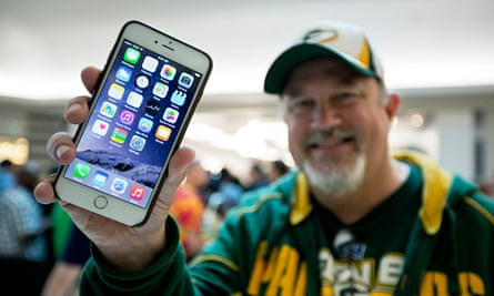 An iPhone 6 buyer shows off his new purchase