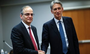 British Foreign Secretary Philip Hammond shakes hands with Syrian National Coalition President Hadi al-Bahra at the end of a media briefing at the United Nations headquarters in New York