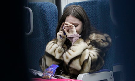 A woman cries while talking on the phone