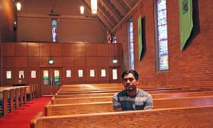 Francisco Aguirre, a community activist who first came to the US from El Salvador two decades ago, in the church where he has taken refuge.