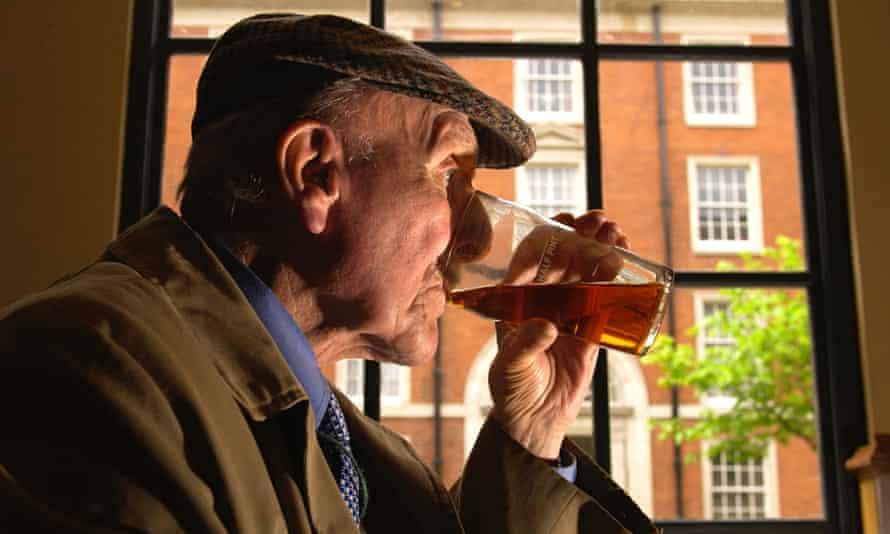 Older man drinking pint of beer