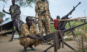 Rebel soldiers guard the village of Majieng, around 6km from the town of Bentiu, in South Sudan, in September, after renewed fighting between government and rebel troops. (AP Photo/Matthew Abbott)