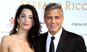 George Clooney arrives with his fiancee Amal Alamuddin