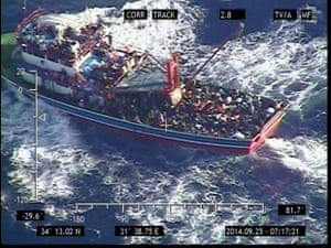 A handout image released by the Cyprus Defence Ministry on 25 September 2014 shows a large fishing trawler overloaded with people off Paphos, Cyprus. A cruise ship rescued 300 Syrian migrants who were crowded into a tiny fishing vessel in rough seas off the southern coast of Cyprus after coast guard officials picked up a distress signal, the Defence Ministry said.