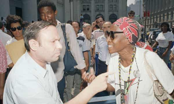 Opposing factions in the Yonkers housing battle air their views outside the New York federal court building in 1988.