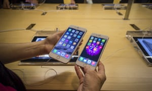 A customer in the Apple store in Grand Central Terminal in New York compares an iPhone 6 and a 6 Plus. Apple announced that it had sold 10 million units of its new phones over last weekend, and rebuffed claims that the phones are prone to bending in normal use.