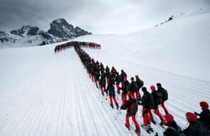 A line of several hundred metres of skiers forming an arrow snaked up the side of the mountain on the Julier Pass in Switzerland.