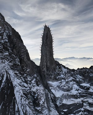 28 mountain guides climbing a rocky needle, turning it into what must surely be the biggest and most spectacular rock cactus in the Alps. The Ago del Torrone in the Bregaglia range, also known as Cleopatra?s Needle.