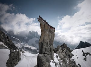 The team of mountain guides assembled on a narrow ledge for Mammut boot control test event. Location: Kleines Kamel, Furka Pass, Wallis, Switzerland.