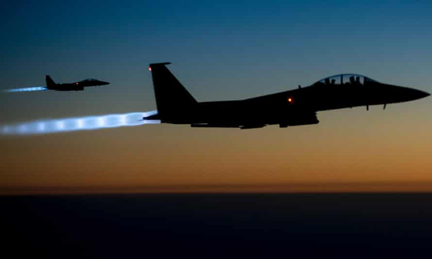 A pair of U.S. Air Force F-15E Strike Eagles fly over northern Iraq after conducting airstrikes in Syria.