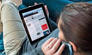 Woman reading Financial Times on iPad
