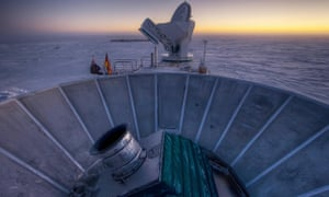 The Bicep2 telescope, foreground, and the South Pole telescope in Antarctica