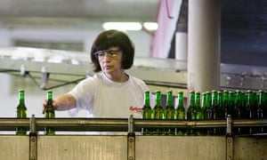 A Czech worker in the bottling plant of the Budweiser Budvar brewery. One in five young Czechs is out of work.