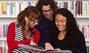 international students reading a book