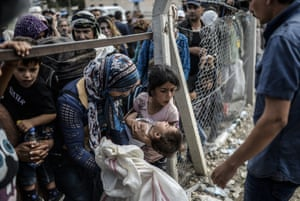 Tens of thousands of Syrian Kurds flooded into Turkey fleeing an onslaught by the jihadist Islamic State group that prompted an appeal for international intervention