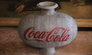 A Han dynasty vase with Coca-Cola logo seems to mock its surroundings.