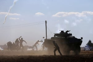 Reuters photographer Murad Sezer was also covering the situation at the border near Suruç. Here, Turkish Kurdish demonstrators clash with Turkish security forces during a pro-Kurdish protest. The security forces used tear gas and water cannon to disperse the Kurds who had gathered in support of the refugees fleeing the attacks in Syria