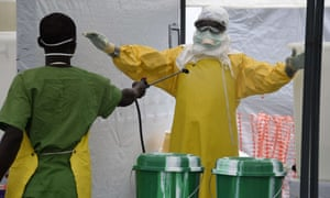 A health worker is decontaminated at a medical centre in Monrovia this week.