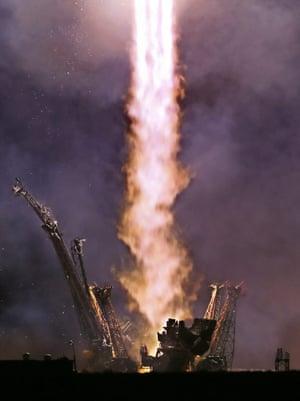 The Soyuz TMA 14 M blasts off from Baikonur cosmodrome in Kazakhstan, carrying Russian cosmonauts Alexander Samokutyaev and Elena Serova and NASA astronaut Barry Wilmore to the International Space Station