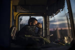 A driver sits inside a bus during an exchange of prisoners-of-war near Donetsk, Ukraine. The two sides, that of the government forces and the pro-Russian separatists, are exchanging the prisoners under the terms of the current ceasefire