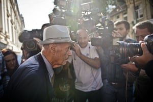 Alexandru Visinescu leaves the court after attending the first day of his trial in Bucharest. The former chief of a notoriously brutal communist-era prison camp in Romania is being tried for alleged crimes against humanity