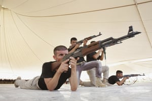 About 500 Shi'ite volunteers from Tal Afar attend a military training session in Karbala, Iraq, to join the fight against the jihadists of the Islamic State