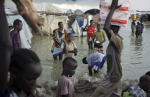 South Sudanese walk through floodwaters to move around a makeshift camp for the displaced at the United Nations Mission in Bentiu, South Sudan. The Doctors without Borders aid agency reported that the South Sudanese residing there are living in knee-deep, sewage-contaminated floodwater, stating that the conditions in the camp are 'an affront to human dignity'