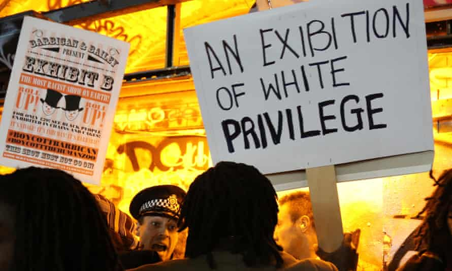 Protesters with placards gather at the entrance of the Vaults Gallery during a protest that lead to Exhibit B by South African artist Brett Bailey being cancelled.