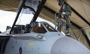 An RAF Tornado pilot entering an aircraft at RAF Akrotiri in Cyprus.