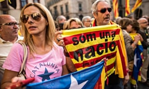 People gather in front of the Catalan government building during a pro-independence demonstration in