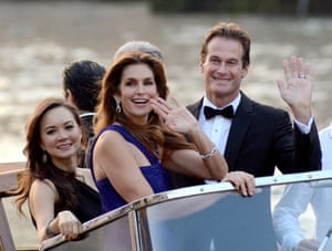 Clooney's best man, Rande Gerber with his wife Cindy Crawford, wave to the crowds