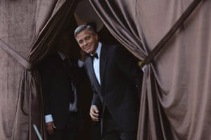 George Clooney smiles as he arrives at the Aman Hotel for his wedding dinner