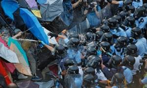 Riot police fire pepper spray against protesters near government headquarters in Hong Kong