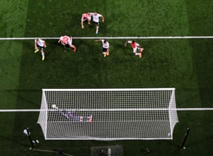 Hugo Lloris of Tottenham saves a shot from Per Mertesacker of Arsenal.