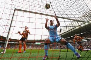 Sergio Aguero of Manchester City celebrates Edin Dzeko's goal.