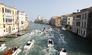Boats surround the taxi boat transporting George Clooney and his wife Amal Alamuddin on the Grand Canal.