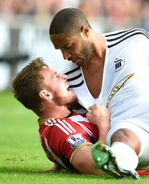 Sunderland's Connor Wickham (left) argues with Swansea City's Ashley Williams.
