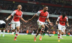 Alex Oxlade-Chamberlain celebrates scoring for Arsenal.
