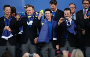 The players take photographs of the crowd at the closing ceremony