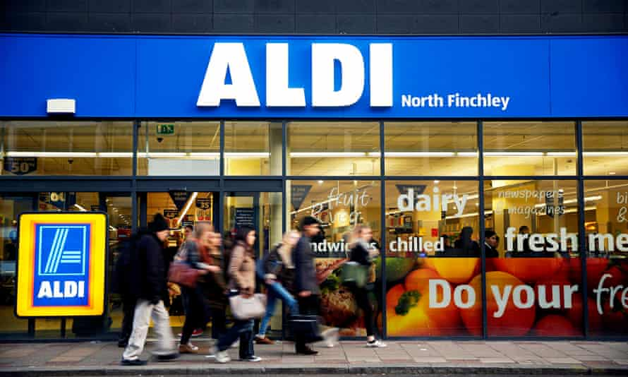 Pedestrians pass an Aldi supermarket in the North Finchley district of London. The chain is currentl