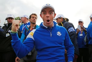 Rory McIlroy celebrates on the 15th green after hearing that Europe have won the Ryder Cup.