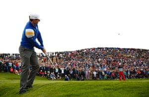 Rory McIlroy chips onto the 8th green.
