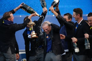 Paul McGinley, the Europe captain, is doused with champagne.